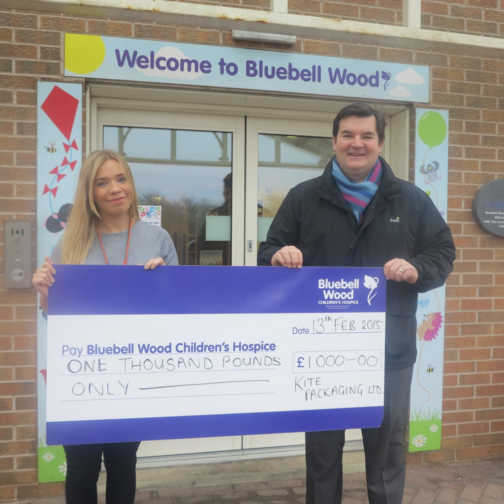Chris OReilly, MP for Kite Packaging Northern presents a cheque to Bluebell Wood Hospice