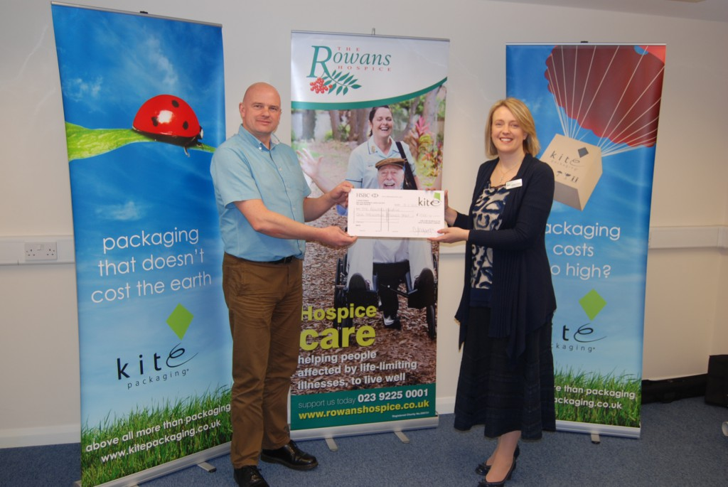 Chris Ireland, Office Manager at Kite Packaging South Coast presents cheque to Rowans Hospice